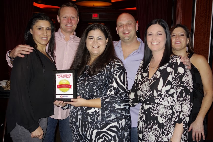 Elite Supplier of the Year: Hit Promotional Products. Pictured (from left): Jennifer Grigorian, VP of Marketing; Mike Merkin, Regional Sales Manager; Hope Binegar, ePromos' Senior Supplier Relations Manager; Mike Leone, Sales Manager; Crystal Jewel, Inside Sales Rep; Sheila Johnshoy, ePromos' Vice President of Marketing