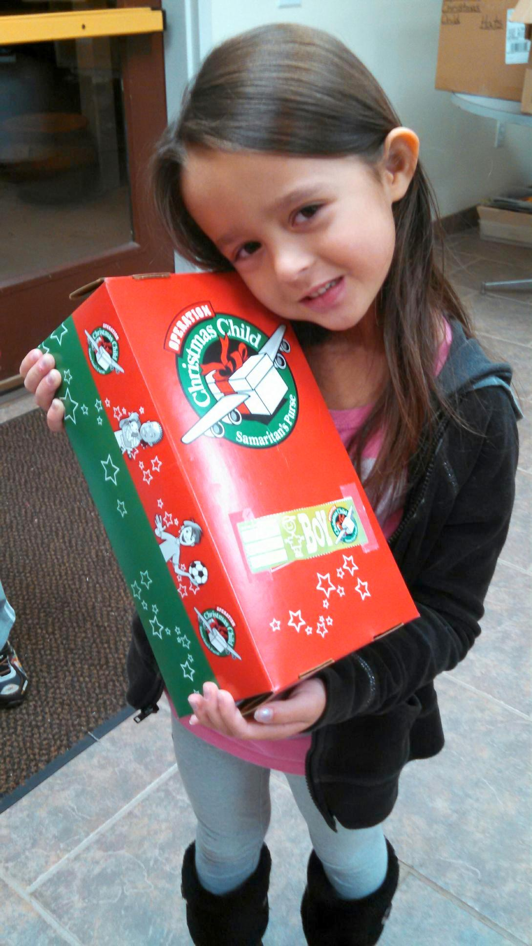 Aubrey donating to Operation Christmas Child
