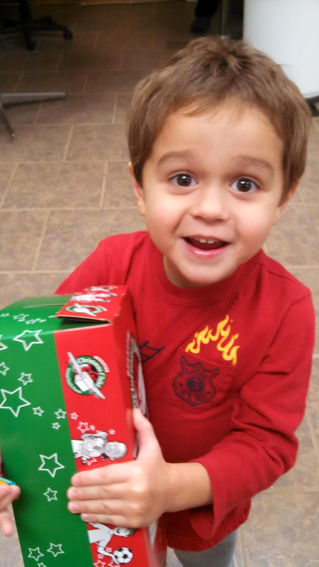 Hope's son, David, showing off a box he filled for Operation Christmas Child