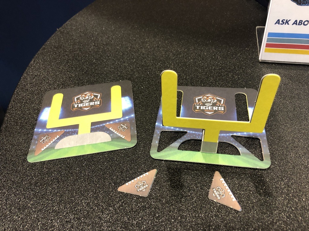 Disposable coasters with field goal cut out makes for great entertainment